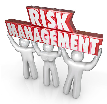 cost reduction: Risk Management words lifted by team of people or workers to illustrate a company or oranizations commitment to reducing risks and liability to damage and financial loss