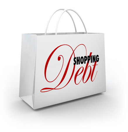 way out: Shopping Debt words on a bag illustrating spending too much money on goods and merchandise at a retail store and amassing large amounts of credit card debt - the excess of consumerism Stock Photo