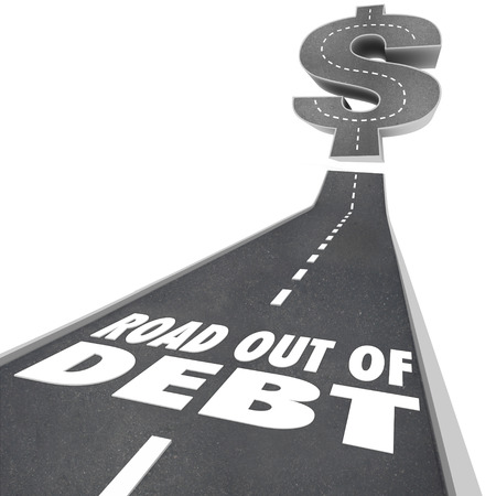 credit card debt: Road Out of Debt words on a black pavement street illustrating help or assistance through credit counseling or payment restructuring through a bank or creditor for economic relief from bills