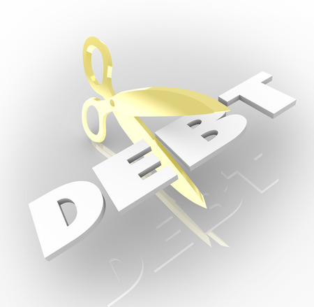 pay: Debt word cut by scissors to illustrate cutting money owed to creditors by being over budget and too much spending