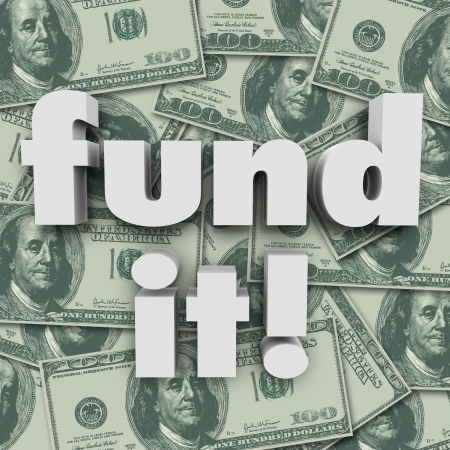 campaigns: Fund It words on a background of hundred dollar bills to illustrate funding a start-up company, non-profit, charity or other organization or group