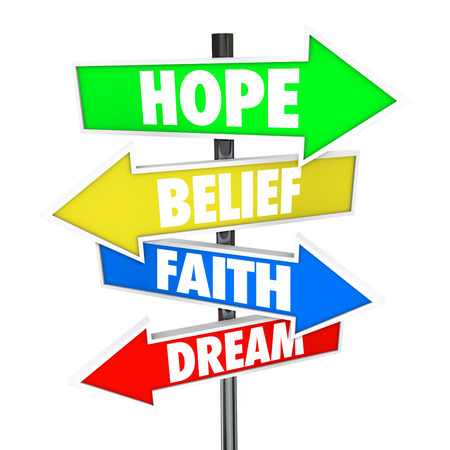 desires: Hope, Belief, Faith and Dream words on arrow road signs pointing to the future and how to achieve your desires with a positive attitude in work or life Stock Photo