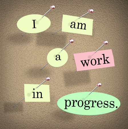 am: I Am a Work in Progress quote or saying on pieces of paper pinned to a bulletin board to illustrate accepting your flaws or imperfections while improving your life