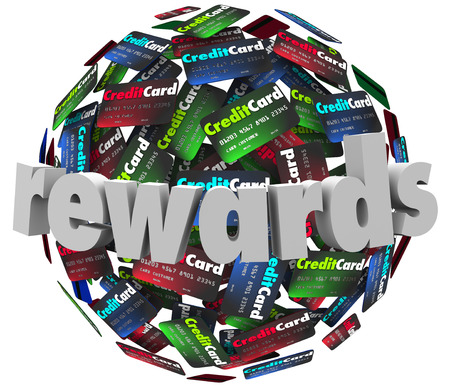 debit cards: Rewards word on credit cards to illustrate a customer reward loyalty program that awards you points on purchases Stock Photo