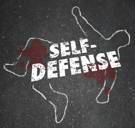 Self Defense words on a chalk outline of a dead body or victim to illustrate the need to defend yourself from a violent attack Archivio Fotografico