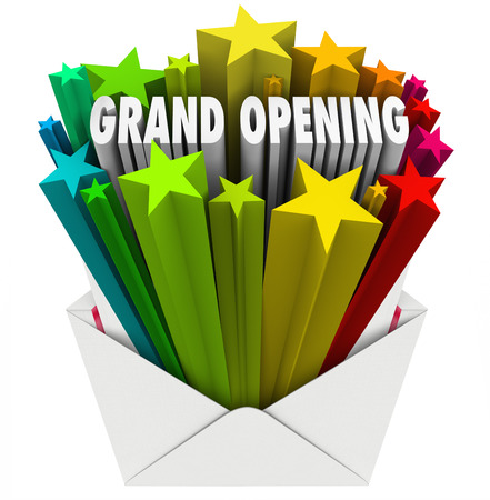 new start: Grand Opening words shooting out of an envelope or letter to illustrate the excitement of a new store, company or business beginning business with a special event or sale to attract customers Stock Photo