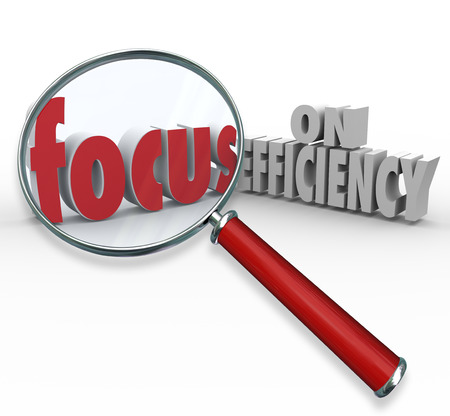 efficacy: Focus on Efficiency words under magnifying glass to illustrate searching or looking for ideas on how to increase efficiencies and effectiveness in working toward a goal or mission Stock Photo