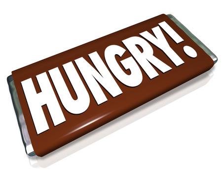 candy bar: Palabra hambre en una barra de chocolate de caramelo envoltorio marr�n para ilustrar un hambre o antojo de comida chatarra y bocadillos de az�car