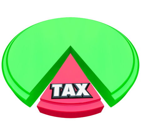 Tax word on a pie chart to illustrate the high percentage or share of income or revenue to be paid to government in taxation on money income earned  Foto de archivo