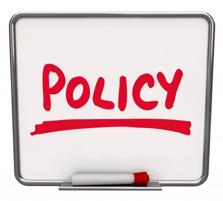 Policy word written on a dry erase board with red marker to illustrate compliance with rules and guidelines in a business, company, team or organization photo