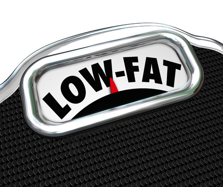 lowfat: Low-Fat words on a scale to illustrate the importance of healthy and nutritional food choices in losing weight and leading a healthful lifestyle Stock Photo
