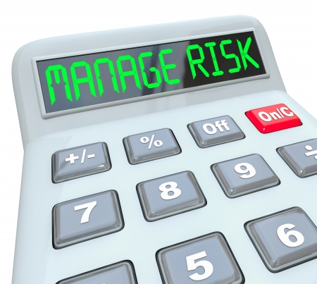 cost reduction: Manage Risk words on a calculator to illustrate financial compliance and money auditing in accounting and bookkeeping of income, revenue and profit Stock Photo