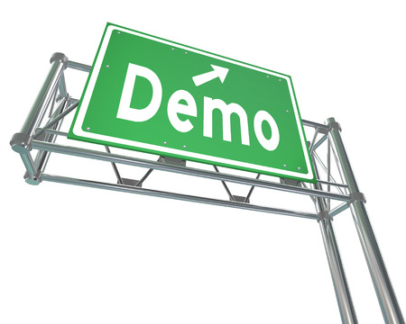 Demo word and arrow on a green freeway or highway road sign directing you to a product or service demonstration, free trial or example