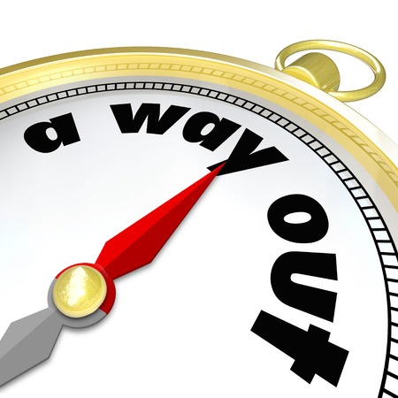 way out: A Way Out words on a gold compass to illustrate finding direction to get out of a difficult challenge, maze, puzzle, problem or issue Stock Photo