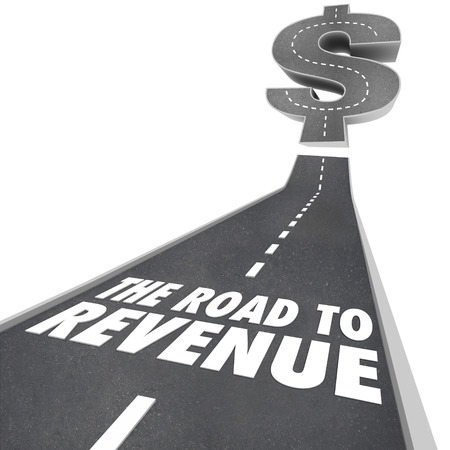 increasing: Road to Revenue words on a street or pavement with arrow rising up to illustrate making money and growing profits