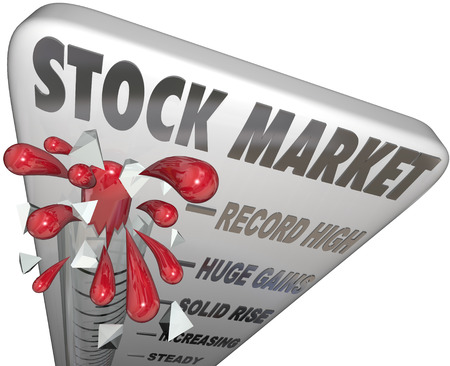 rising prices: Stock Market words on a thermometer to illustrate rising prices and values of investments