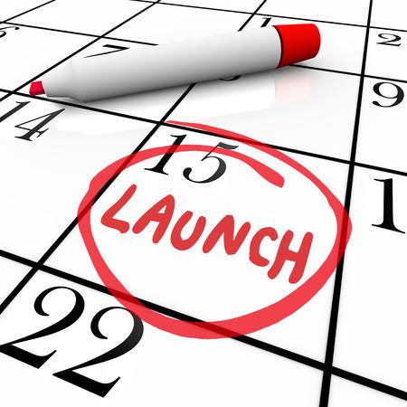 Parola di lancio cerchiata sul calendario per data con un pennarello rosso per illustrare l'inaugurazione, il debutto o prima di un nuovo prodotto o servizio Archivio Fotografico - 25114235