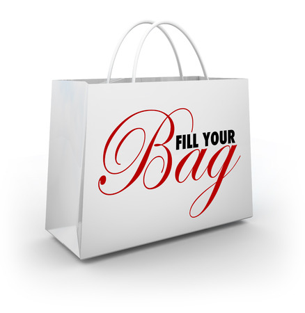 shopping binge: Fill Your Bag words on a shopping bag to illustrate a spending spree or spluring and binging on merchandise at a retail store Stock Photo