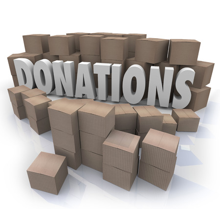 volunteerism: Many cardboard boxes of donated items, clothes, food and other goods in need around the word Donations to illustrate a charity drive collection warehouse Stock Photo