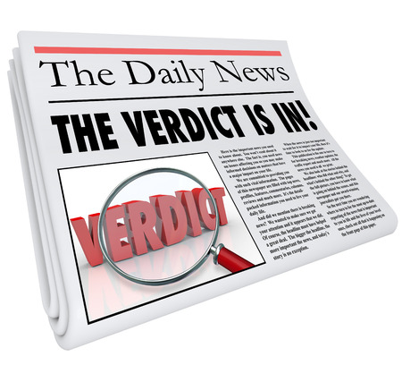 The Verdict is In headline on a newspaper to announce or report the answer, judgment or finding of a court case or other important decision photo