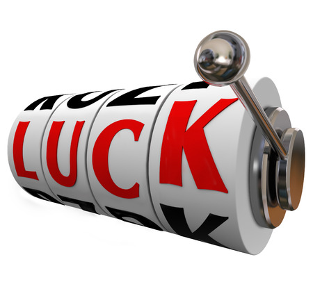 fateful: Luck word on slot machine wheels in a game or casino Stock Photo