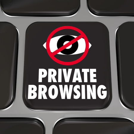 Private Browsing and an eye symbol on a computer laptop keyboard key photo