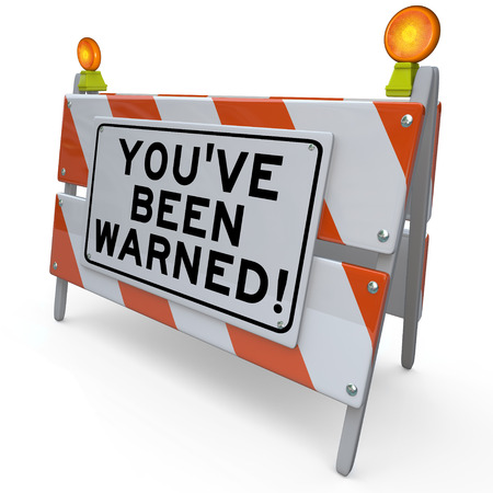 Youve Been Warned words on a blockade or road construction barrier sign Stock fotó