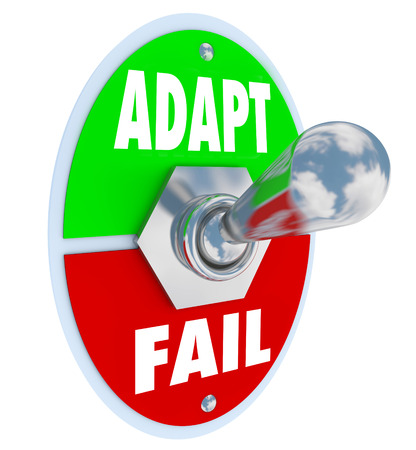 failing: Adapt Vs Fail words on a toggle switch lever to illustrate changing and innovating to survive and thrive in job, career or life Stock Photo