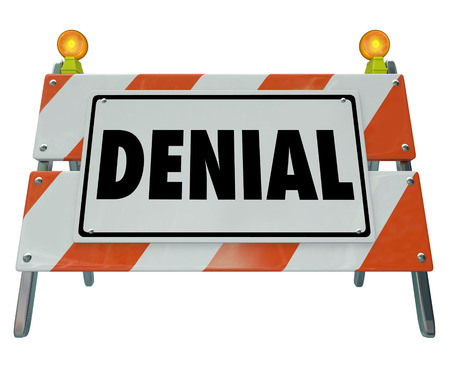 denied: Denial word on a road construction barricade sign to block forbidden access and to illustrate rejection, declined or a negative answer