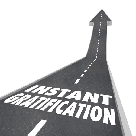The path to instant gratification illustrated by a road with the words and arrow pointing you in the direction to enlightenment, pleasure or immediate satisfaction and peace Stock Photo - 26058301