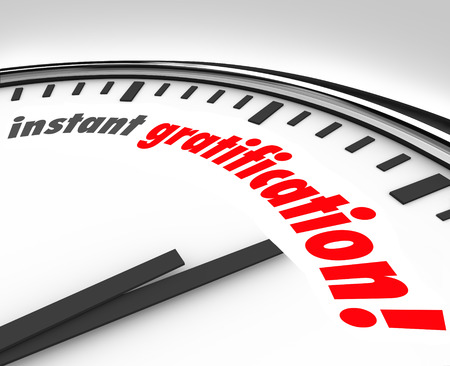 fulfillment: Instant Gratification words on a white clock face to illustrate fast or immediate satisfaction, pleasure or contentment from work being done or complete, or a taste or sensation