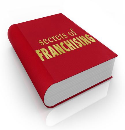 franchising: Secrets of Franchising title on a book to illustrate instructions, how-to information, advice and tips on successfully managing or running a licensed chain restaurant or other store or business