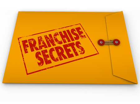 authorizing: Franchise Secrets red stamped words on a yellow classified or confidential envelope to illustrate important vital information, advice or tips on managing a licensed chain business or company