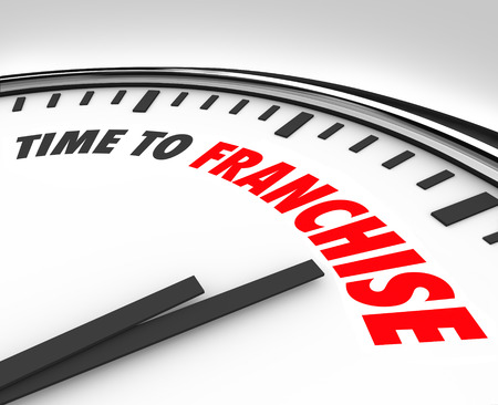 licensing: Time to Franchise words on a clock to illustrate a new business opportunity of licensing an established brand for a restaurant, gas station, store or other chain company Stock Photo