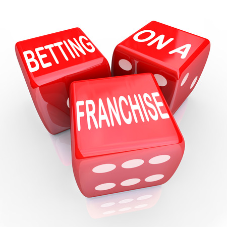 authorizing: Betting On A Franchise words on three red dice to illustrate gambling or taking the risk of starting a new business with the strength of an established brand license