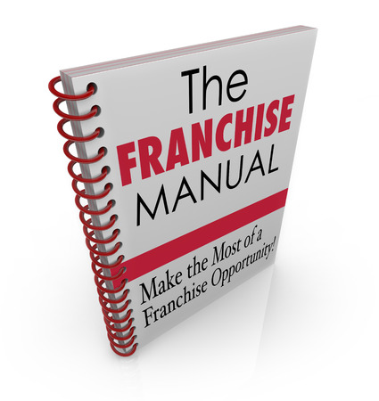 authorizing: Franchise Manual words on a spiral bound book cover illustrating instructions on securing and managing a chain business like fast food restaurant, gas station, repair shop or other company