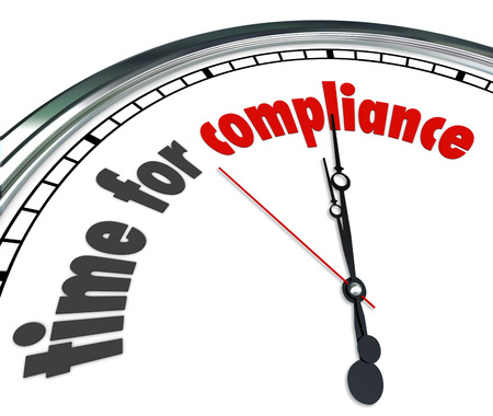 Time for Compliance words on a white face clock to illustrate the legal importance of following and complying with laws, guidelines, regulations, restrictions, policies, procedures and rules photo