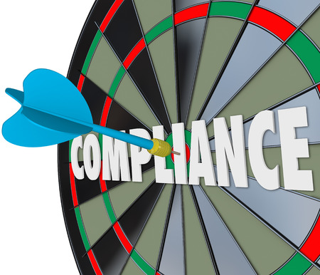 Compliance dart hits a board on the word to illustrate following and complying with laws, guidelines, ordinances, rules, policies and procedures to avoid legal trouble photo