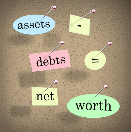 assets: Assets minus debts equals net worth words on pieces of paper pinned to a bulletin board to illustrate accounting principles and equation in figuring and adding your total financial value