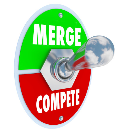 merging together: Merge Vs Compete words on a toggle switch to illustrate combining businesses to create a new, larger, stronger company vs competing with other organizations for market share Stock Photo