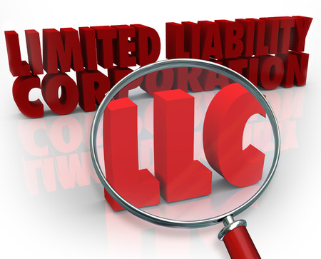 entity: Magnifying glass on the acronym LLC standing for Limited Liability Corporation to illustrate the search for information, help, advice and tips on setting up this efficient business model license Stock Photo