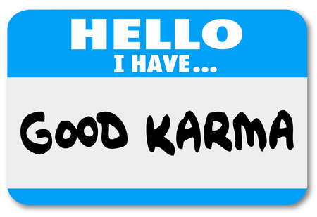 Good Karma words on a Hello name tag sticker  photo