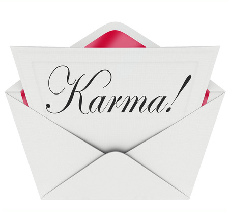 Karma word on a note or letter inside an open envelope Stock Photo - 26582487