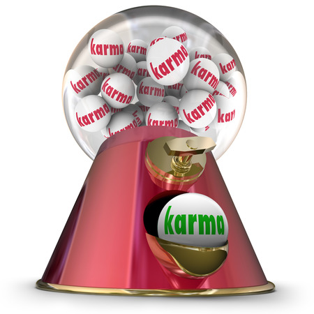 Karma word on gum balls in a dispenser machine photo