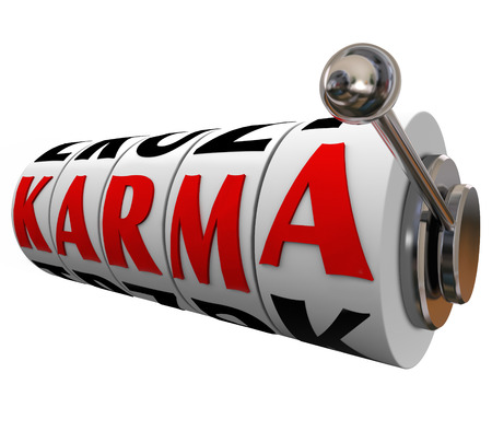 Karma word on slot machine wheel photo