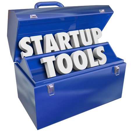 Startup Tools words in a blue metal toolbox to illusrate new business or company launch