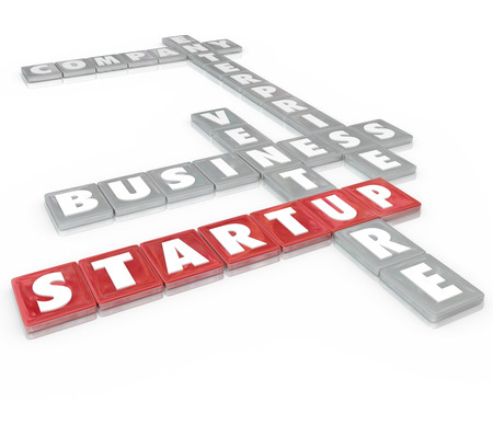 winning proposal: Startup words on letter tiles including company, enterprise, business and venture to illustrate starting a new organization or opportunity to earn money