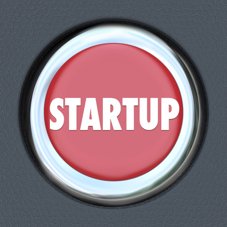Startup word on a red round car ignition button