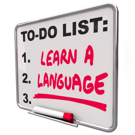 foreign: Learn a Language words on a to-do list to illustrate the value and skill in learning and practicing a foreign or international dialect