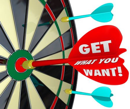of what: Get What You Want words on a dart board and a direct hit to illustrate a winning competitor in a game to achieve your most desired result